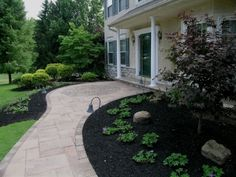 This would be heaven.A serpentine walkway of Techo Bloc Inca Slabs with a paving brick circle kit that coordinates with the Techo Bloc paving bricks installed on the front porch. Front Porch Landscape, Front Yard Landscaping, Landscaping Ideas, Walkway Ideas, Porch Ideas, Front Path, Front Walkway, Outside Living, Outdoor Living