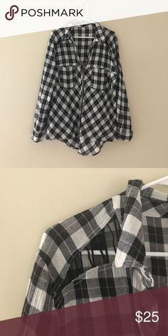 Free people Flannel Black checkered flannel. Long sleeve. Button up. Detail on shoulders. Great condition. Smoke free pet free home. Free People Tops Button Down Shirts