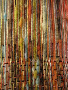 art yarn on backstrap!