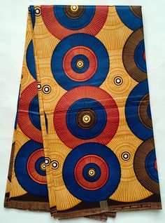 House of Mami Wata African Print Fabrics  https://www.etsy.com/listing/595267085/african-print-fabric-ankara-blue-brown