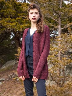 Elegantly simple, this top-down raglan cardigan is sure to be a wardrobe staple. Knit seamlessly with an extra-long silhouette, this cardigan shows off a tweedy yarn.