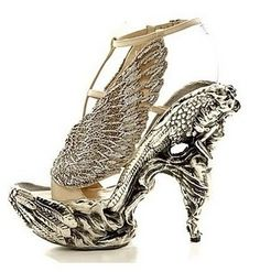 Mcqueen... Gaudy but I just love these statement shoes, but somehow I don't even know why.