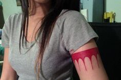 The same armband tattoo that Pocahontas had!!! I would never do that myself but it's such a cool idea!