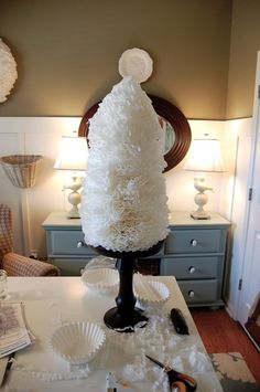 Coffee Filter Tree : DIY craft with folded coffee filters, glue gun and a cone.  She shows you the same concept with a wreath.