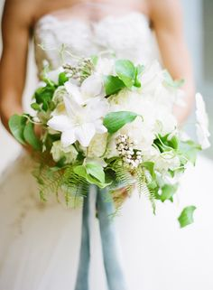 Clematis bouquet with blue silk ribbons
