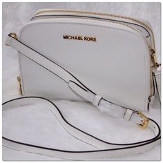 Michael Kors Reese Messenger Crossbody This Michael Kors Reese Messenger Is Casual And Refind And Can Also Be Used As A Shoulder Bag Complete With A Detachable Strap, Magnetic Snap Closure, Logo Jacquard Lining, Protective Gold-Tone Metal Feet, Two Exterior Zip Compartments, Two Interior Slip Pockets, Six Interior Credit Card Slots, One Interior Zip Compartment In An Optic White Leather With Gold -Tone Metal Logo And Hardware Makes It A Must Have! New With Tags. Michael Kors Bags Crossbody…