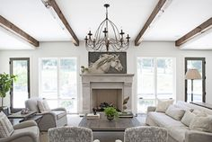 Living Room Wood Beams - Design photos, ideas and inspiration. Amazing gallery of interior design and decorating ideas of Living Room Wood Beams in living rooms, kitchens by elite interior designers. Chic Living Room, Living Room With Fireplace, Living Room Grey, Home Living Room, Living Room Furniture, Living Room Designs, Living Spaces, Tall Fireplace, Fireplaces