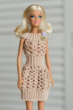 holiday clothes A beige crochet dress for Barbie will be needed in your doll's wardrobe. The dress will be a good gift for the holiday. Product length is . The dress will fit Barbie Crochet Doll Dress, Crochet Barbie Clothes, Doll Clothes Barbie, Barbie Knitting Patterns, Barbie Clothes Patterns, Clothing Patterns, Barbie Outfits, Dress Barbie, Barbie Barbie