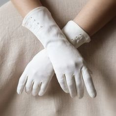 These are the types of gloves that Mrs. Kendal would wear. They would match her white boots and would compliment her very nicely. Gloves were a commonality in the Victorian Era.