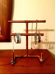 Bend a copper pipe in half for this stunning jewelry organizer idea
