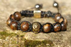 Bracelet perle de pierre Bronzite et perle lion