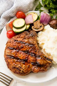 Perfect Grilled Pork Chops are actually really easy to make. Choose the right cut, add some seasoning, and grill the best pork chop you've ever had in your life! Best Grilled Pork Chops, Marinated Pork Chops, Baked Pork Chops, Grilled Meat, Pork Chops On Grill, Grilled Steaks, Grilled Vegetables, Pork Rib Recipes, Grilling Recipes