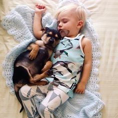 The best kind of nap time - a boy and his puppy