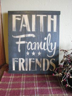 Faith Family Friends Wood Sign Put this cute wood sign up on your wall that says 'Faith Family Friends' in creme paint, on a distressed black base. It is made from 3 sturdy panels, with a keyhole hook
