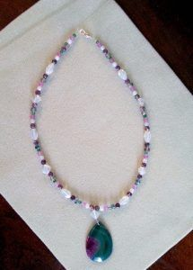 Gorgeous druzy purple and green agate with opalite beads, rainforest beads, purple chalcedony, crystals, and green e beads.