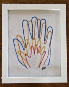 Sewn hand prints. This reminds me of what my dad would make with wood. <3