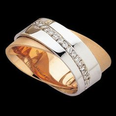 "18ct white and rose gold ""Orbit"" design with channel set brilliant cut diamonds."