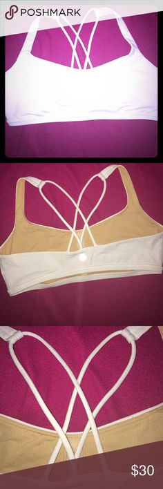 Lululemon Sports Bra A cute women's size 6 Lululemon sports bra it's solid white on the outside and solid nude color on the inside the sports bra has removable padding in the cups And a double strap set on the back the logo is on the back as well in the center in a metallic silver color the sports bra is in great condition still from a smoke and pet free house lululemon athletica Intimates & Sleepwear Bras