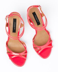 Saw these at the store.  They are 100% neon coral.  This 80s flashback is super cute!