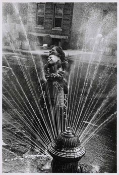 """""""Ultimately photography is about who you are. It's the seeking of truth in relation to yourself"""": Leonard Freed. Photo taken in Harlem, New York City, 1963 when the fire hydrants are opened during the summer heat (© Leonard Freed / Magnum Photos USA) Magnum Photos, Black White Photos, Black And White Photography, Vintage Photography, Street Photography, Art Photography, Amazing Photography, Leonard Freed, Harlem New York"""