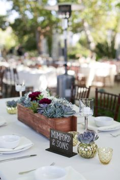 A Nature Inspired Oceanside Wedding via TheELD.com | Rustic table numbers and centerpiece design | Melissa McClure Photography
