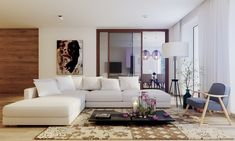 The large sectional sofa in this living room would be easy to sink into from any angle. A low coffee table and tall floor lamp create interesting vertical levels.
