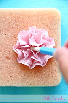 Bella Cupcakes: How to make a ruffle flower Using your small ball tool, gently push into center of your ruffle flower. Transfer your ruffle flower onto your drying palette. At this stage I take my cocktail stick just play with edges a bit to create right look. Now leave to dry overnight + they will be ready to use on your cupcake. Pipe some buttercream onto your cupcake + place your ruffle flower off center. + there you have a gorgeous fondant ruffle flower cupcake.