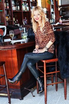 Elle Strauss, senior fashion editor at Lucky Magazine rocking #leatherleggings with a rad pair of boots.
