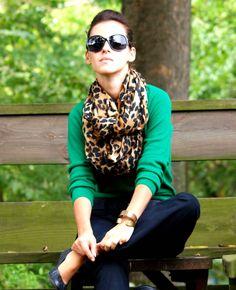 Blue chinos leopard scarf & green jacket.