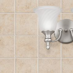 Spruce up your walls with the classic styling of our Brixton glazed ceramic, presented in a 6x6 size. From Bel Terra, you'll find that this tile brings a durable feel, classy look and easy-clean care to your home. The subtle Mediterranean aesthetic and bone-beige color allow for beautiful decorating versatility.