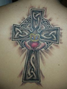 Irish cross with a Claddagh representing love, friendship, and loyalty :)