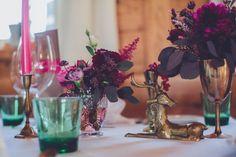 Pink and purple table decor with gold animal figurines | Photo by Chris Spira Photography via http://junebugweddings.com/wedding-blog/romantic-austrian-wedding-wilder-kaiser/