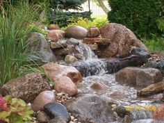 How To Build A Pondless Waterfall | Water Features » Pondless waterfall using logs to create fall