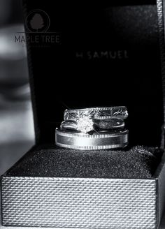 The engagement ring and wedding rings of Marie and Steve.