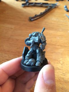 Deathwatch dark angel champion armed with power sword and bolt pistol