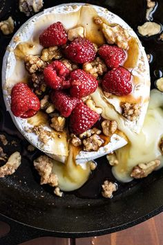 Warm baked brie topped with brown sugar, candied walnuts, and raspberries soaked in a honey balsamic sauce.