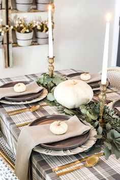 A neutral low-key Thanksgiving tablescape that is simple and inexpensive to recreate using plaid fabric, white pumpkins, eucalyptus, and brass. Thanksgiving Table Settings, Thanksgiving Centerpieces, Diy Thanksgiving, Holiday Tables, Thanksgiving Dinner Tables, Decorating For Thanksgiving, Canadian Thanksgiving, Easter Centerpiece, Thanksgiving Traditions