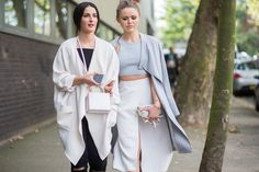 Left, a black top, skinny jeans, and white cocoon jacket are worn with a mini box bag. Right, a gray crop top is worn with a lightweight gray jacket and white skirt.