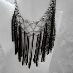Vintage BIB Chocker made by  weaving black and silver chains to create this unique item . This  piece was created between  1975 - 1980  .