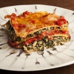 Spinach Lasagna - This lasagna is easy to make, light to eat, and totally yummy. And it's good for you. It's also another great reason to always make extra of our Quick Tomato Sauce for the freezer. Quick as this sauce is to throw together, if you have some on hand, you can put real homemade lasagna on the table in 45 minutes from the moment you thought of it to dishing it up. Great if you have a hungry family to feed. Another shortcut would be to use either prewashed or frozen whole leaf…