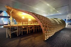 Workspace made from recycled cardboard, brings to mind a cocoon or web, great texture to add to an otherwise ordinary surrounding.