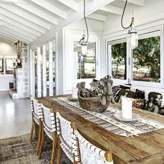 OK, so the things I LOVE about this space. White, easy sight lines to outside, louvers, casual, exposed beams, natural materials. The pin next to this one has a link to more images about this house in Byron. Add to this, sisal rugs, lots of lamps,