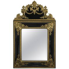 Rare Régence Style Gilt-Bronze Mounted Ebonised Mirror   From a unique collection of antique and modern wall mirrors at https://www.1stdibs.com/furniture/mirrors/wall-mirrors/