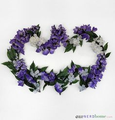 DIY Batman flower wreath:   Community Post: 21 Nerdy Things You Need For Your Home Right Now