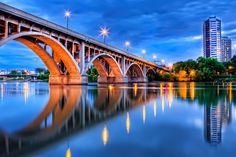 The lights of the Broadway Bridge in Saskatoon reflect in the calm waters of the South Saskatchewan River