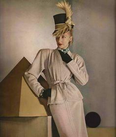 ~1946 ensemble dress suit cream tan winter white jacket skirt color photo print ad model magazine hat gloves tie belt shoulder pads designer 40s wear