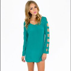HOST PICK Green long sleeved shift dress BEST IN DRESSES AND SKIRTS HOST PICK  The perfect dress for any party!  TOBI In the Rung green dress. cut out down the long sleeves of this green shift dress. Size small! First two pics from Tobi website to show style. Tobi Dresses