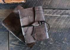 """A gorgeous antique brown book with a burned arrow and an arrowhead and leather lace closure. Measures approximately 6 1/2"""" x 4 1/2"""" and has 192 blank acid free pages (front and back). A beautiful place to write your life story or use for photos, memories, a wedding book, travel log... there are endless possibilities."""