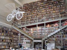 The second bookstore in Portugal listed as a must see. The Devagar Ler Book Store, in Lisbon, where 'the peculiarity is a flying bicycle decorating the place.