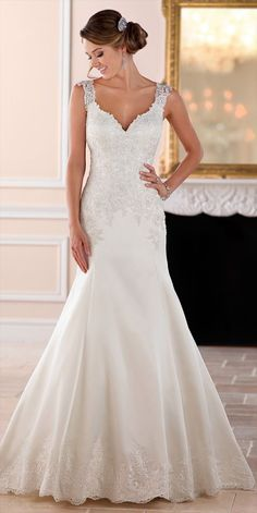 This elegant, sparkling fit-and-flare wedding dress by Stella York is what bridal dreams are made of! Lace on Luxe satin shimmers with Diamante beading in a classic silhouette is perfect for the traditional bride. Giving this dress a fresh update, the back features illusion lace in a mock keyhole with fabric covered buttons that follow down through to the dramatic satin train. The lace covers the bodice and continues through the hips, giving brides a natural hourglass shape. Mirroring the…